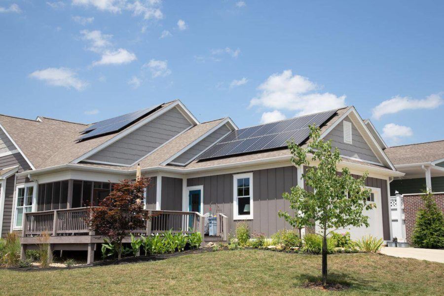 Solar Testimonials Page - Tan house with solar panels and a deck